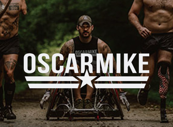 Three men train for athletic fitness.  One of the men is in a sport wheelchair.